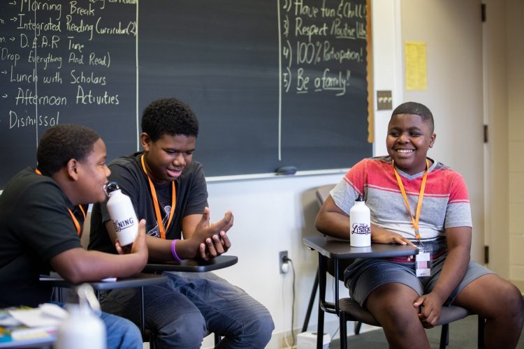 Students talk during an education session