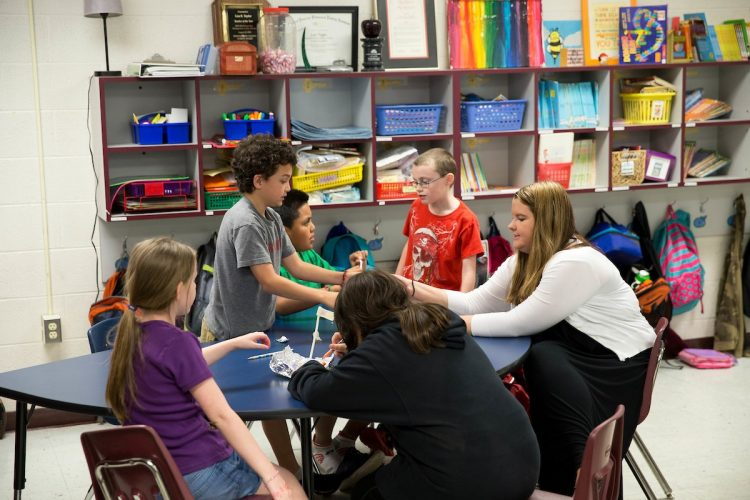 Randolph teaching alumna Kate Thornhill works with students in her elementary school classroom
