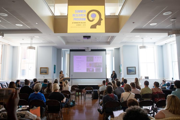 Keyu Jin and Priscilla Ranjitkar deliver their Summer Research presentation in Hampson Commons