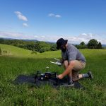 Mitchell Doss prepares a DJI Matrice 100 drone for take-off