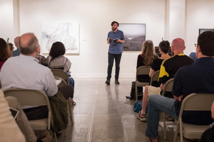 M.F.A. faculty member Kaveh Akbar shares his work during a public reading at the first residency last summer