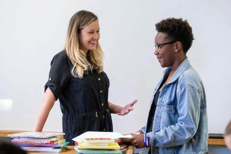 Professor Sara Beck converses with a student