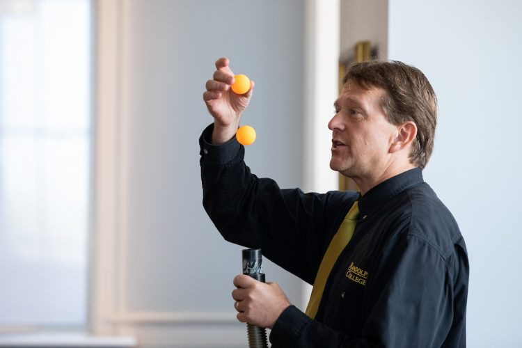 Physics professor Peter Sheldon gives a demonstration for the Physics Phun event during WildCat Weekend