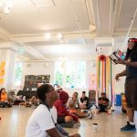 Nick George, founder and executive director of The Listening, Inc., reads from his poetry at the Freedom School.