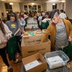 Students pack food during the Give Back event