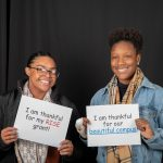 Students pose in the Giving Tuesday photo booth during the day of giving in 2018