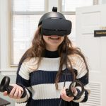 A student uses the virtual reality equipment in the new psychology laboratory