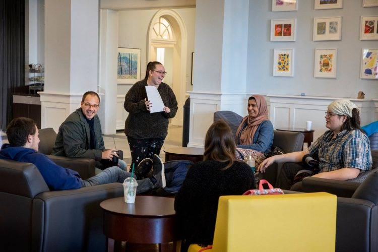Religious studies professor Gordon Steffey meets with a group of students in the Student Center during his office hours