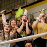 The student section cheers on the WildCats during a basketball game