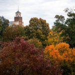 Trees pictured in full fall colors in front of Main Hall