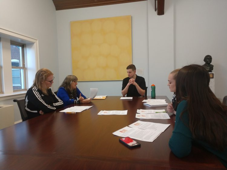 Students in Equine Studies 101 discuss ethical issues during a panel discussion in the Quillian Conference Room