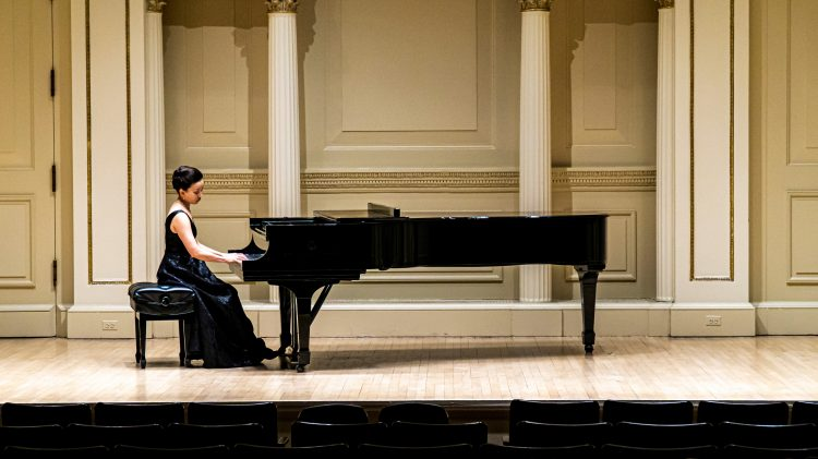 Emily Yap Chua warms up on piano prior to the recital