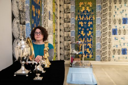 Artist Cheryl Harper installs during current exhibition at the Maier Museum of Art at Randolph College