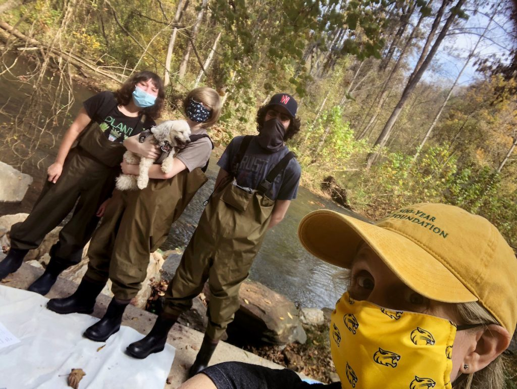 Karin Warren, right, takes a photo with Sarah Greene '24, Hailey Gilman '22, and Alex Long '22 during their work at Blackwater Creek.
