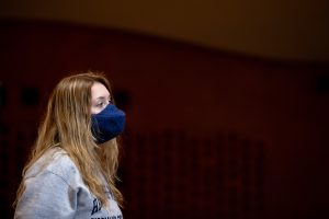 Kayla Morris' 22 uses a specially designed mask to sing during a class.
