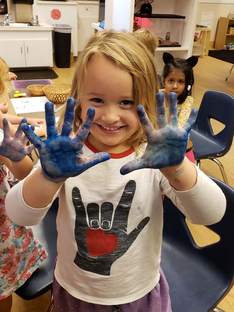 Painting is fun at Randolph College Nursery School