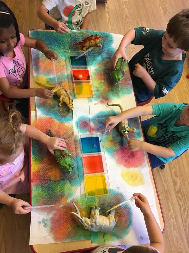 Painting dinosaurs at Randolph College Nursery School