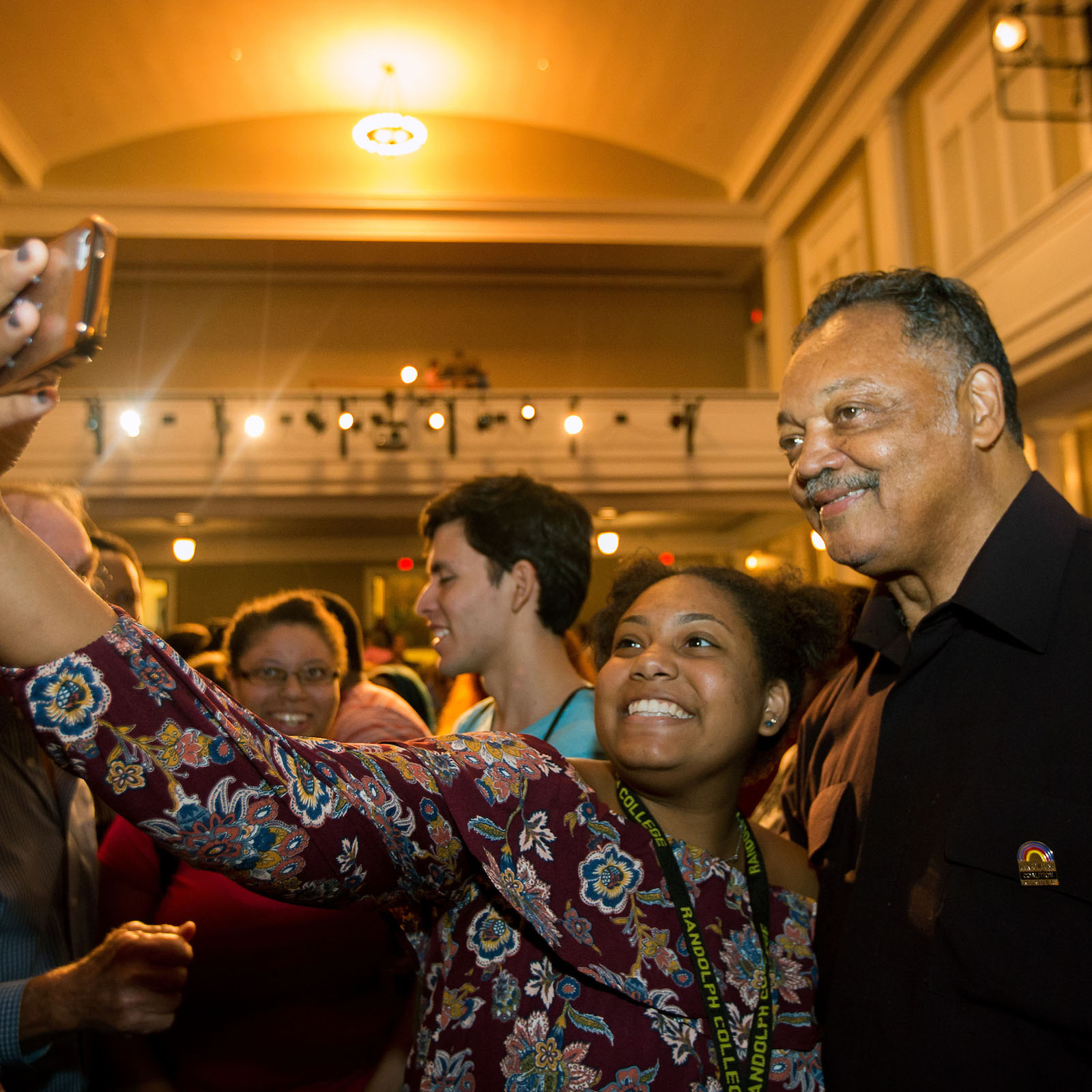 Young Randolph College student takes a selfie with civil rights leader Rev. Jesse Jackson