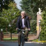 President Bradley W. Bateman riding a bicycle to work