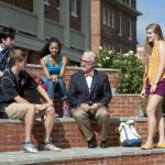 President Bradley W. Bateman meets with a group of students on the steps of the Michels Plaza fountain