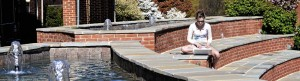Banner image - student by fountain in Michels Plaza