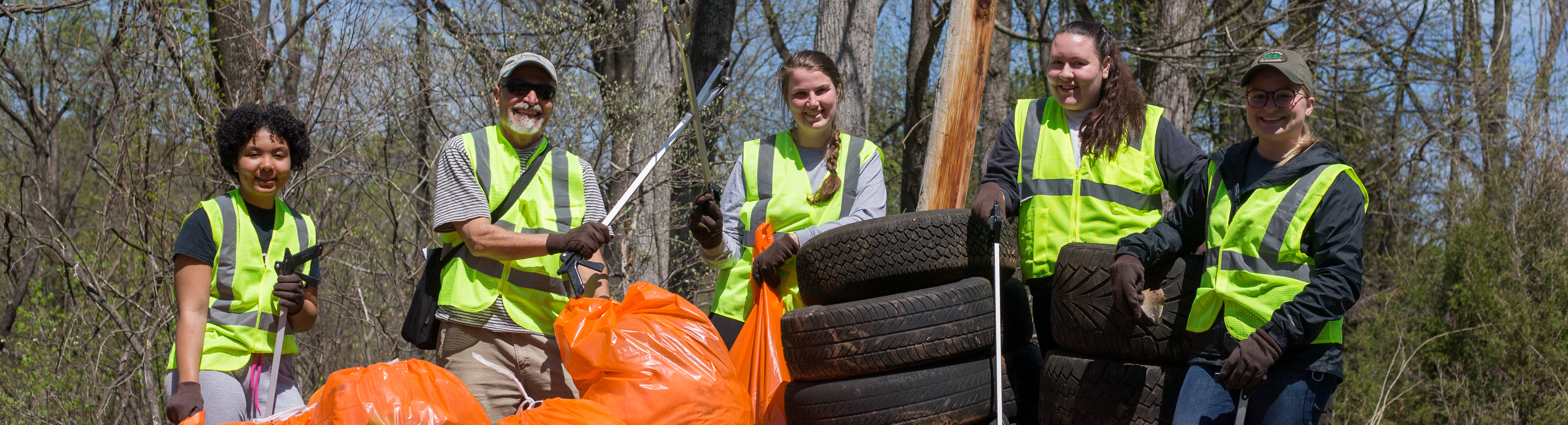 Students out in the community picking up trash.