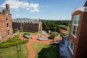 The fountain and Chilhowie bricks of Michels Plaza behind the Student Center as seen from residence room 370 in Main Hall.