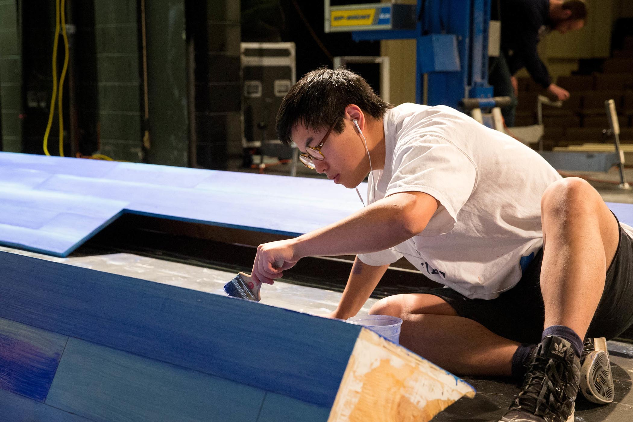 Randolph student paints scenery as part of internship with Endstation Theatre.
