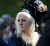 Woman in graduation cap and gown.
