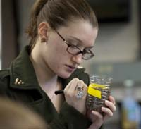 A student examines soil samples.