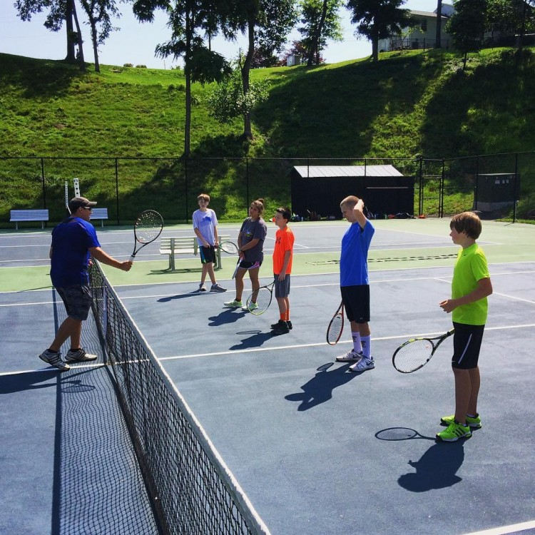 Kids receive instruction at Randolph College tennis camp.